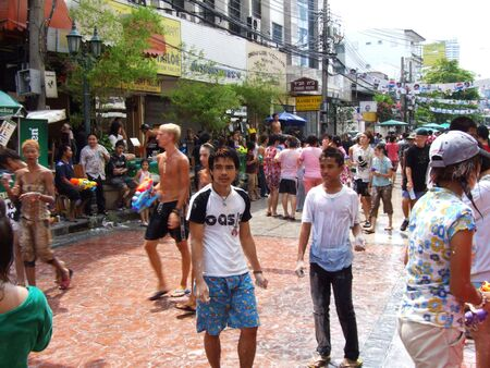 BANGKOK, THAILAND - APRIL 13: People throw water to celebrate the Songkran new year festival on April 13, 2007 in Bangkok, Thailand. The water is thrown because April is Thai summer and 40 degrees Celsius.
