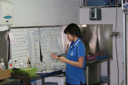 BANGKOK, THAILAND - JULY 23: Thai marine scientist does various tests to maintain the sea animals correct habitats at the Siam Ocean World in the Siam paragonon July 23, 2008 in Bangkok, Thailand.