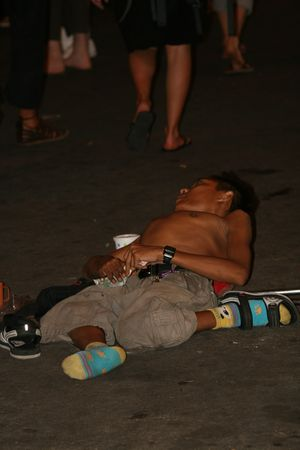 BANGKOK, THAILAND - APRIL 3: Thai crippled man lies and begs for money from tourists on Khaosarn road on April 3, 2009 in Bangkok.