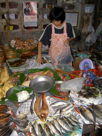 PATTAYA, THAILAND - JUNE 2: Thai woman sells fish in a market on June 2, 2005 in Pattaya.  Stock Photo - 7514759