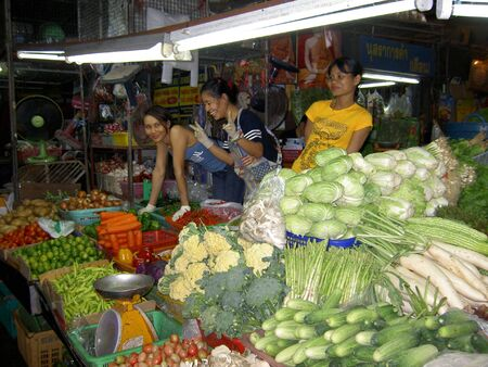 PATTAYA, THAILAND - JUNE 2: Thai woman sells vegetables in a market on June 2, 2005 in Pattaya.  Editorial