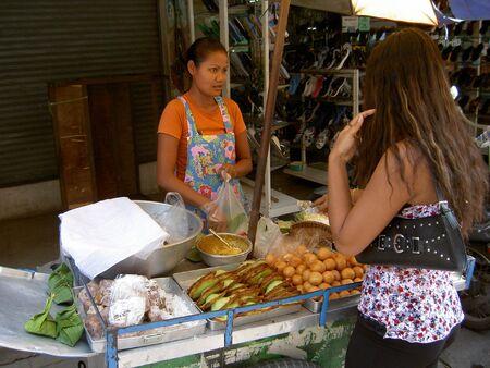 PATTAYA, THAILAND - JUNE 2: Thai woman sells Thai snacks in a market on June 2, 2005 in Pattaya.