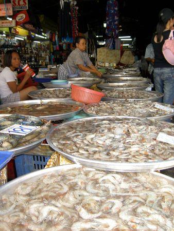 PATTAYA, THAILAND - JUNE 2: Thai woman sells seafood on June 2, 2005 in Pattaya.  Stock Photo - 7514770