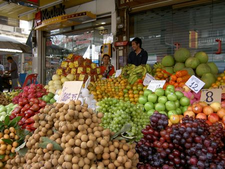 asian produce: PATTAYA, THAILAND - MARCH 12: Thai woman sells fruit in a market on March 12, 2005 in Pattaya.  Editorial