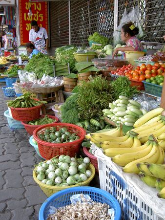 PATTAYA, THAILAND - MARCH 12: Thai woman sells fruit and vegetables in a market on March 12, 2005 in Pattaya.