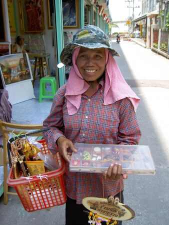 PATTAYA, THAILAND - MARCH 15: Thai woman selling religious ornaments on the roadside on March 15, 2006 in Pattaya.  Stock Photo - 7514787