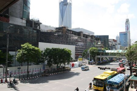 june 25: BANGKOK, THAILAND - JUNE 25: Central world shopping center being rebuilt after red shirt protesters set it on fire on June 25, 2010 in Bangkok.