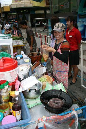 PATTAYA, THAILAND, JUNE 5: Thai woman sells Thai foods by the roadside on June 5, 2010 in Pattaya.