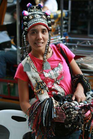 BANGKOK, THAILAND - SEPTEMBER 16: Thai hill tribe woman sells Jewelery at the Chang world Reggie festival on Khaosarn road. September 16 2009 in Bangkok.