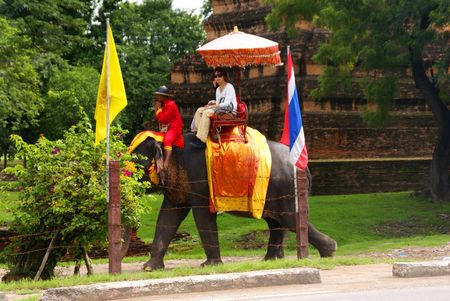 AYUTTHAYA, THAILAND - SEPTEMBER 6: Thai people on an elephant ride tour of the ancient city on September 6, 2010 in Ayutthaya.