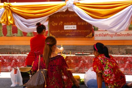 NAKON NAYOK, THAILAND - SEPTEMBER 14: Thai women worship a Buddhist shrine on September 14, 2010 in Nakon Nayok.