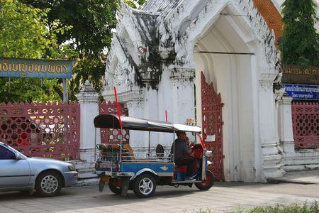 BANGKOK - SEPTEMBER 24: Thai tuk tuk taxi outside a temple on September 24, 2010 in Bangkok, Thailand.
