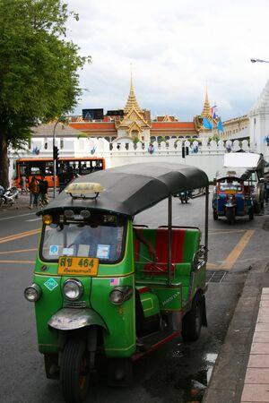BANGKOK - SEPTEMBER 27: Thai tuk tuk taxi waiting for customers outside the grand palace on September 27, 2010 in Bangkok, Thailand.