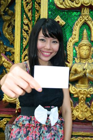 Asian woman holding card in Bangkok, Thailand. photo