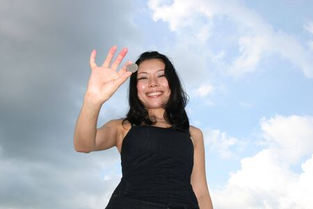 Asian woman under a blue sky. Stock Photo - 7986812
