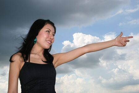 Asian woman under a blue sky in Thailand. photo