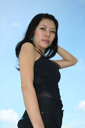 Asian woman under a blue sky in Thailand. Stock Photo - 7986777