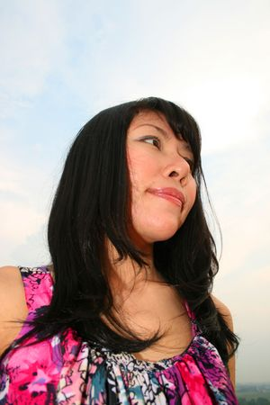 Asian woman under a blue sky. Stock Photo - 7986783