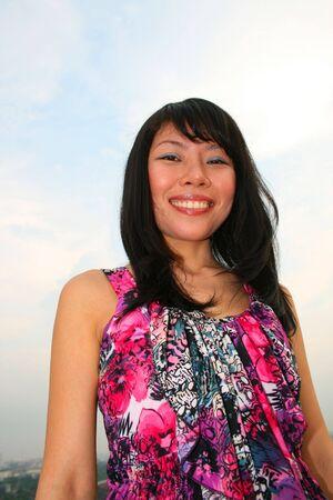 Asian woman under a blue sky. Stock Photo - 7986778