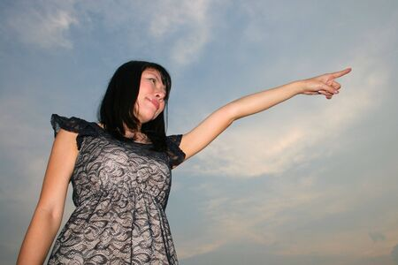 Asian woman under a blue sky. photo