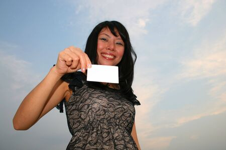 Asian woman holding card. photo