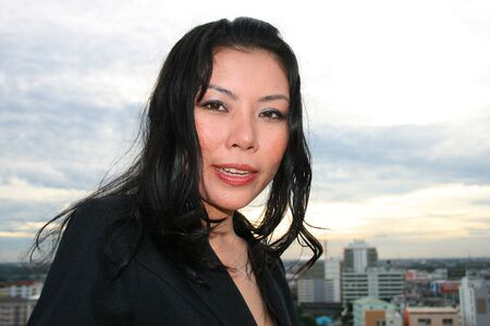 Asian business woman outdoors in Thailand. Stock Photo - 8026246