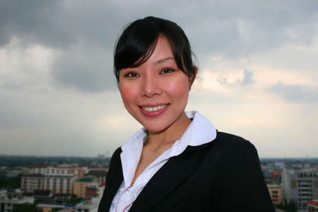 Asian business woman outdoors in Thailand. Stock Photo - 8113952