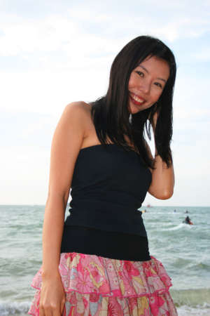 Asian girl on Pattaya beach, Thailand. photo