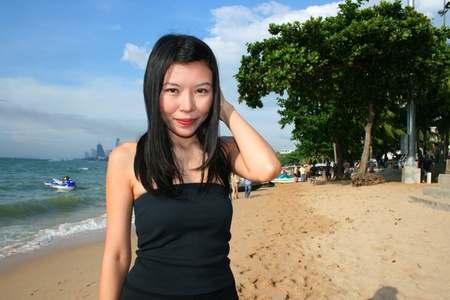 Asian girl on Pattaya beach, Thailand. Stock Photo - 8329592