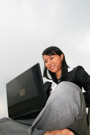 Asian business woman outdoors. photo