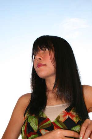 Japanese girl under a sunny blue sky in Thailand. photo