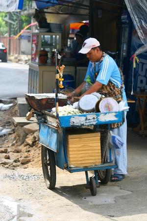BANGKOK- SEPTEMBER 13: Thai people sell food by the road on September 13, 2010 in Bangkok, Thailand.