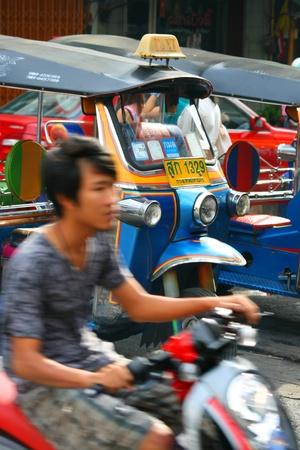 BANGKOK - SEPTEMBER 13: Thai tuk tuk taxi waits for customers on September 13, 2010 in Bangkok, Thailand.