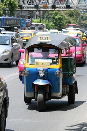 BANGKOK, THAILAND - JUNE 25: Tuk tuk taxi in central Bangkok on June 25, 2010 in Bangkok.