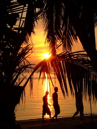 Sunset over a beach in Thailand.
