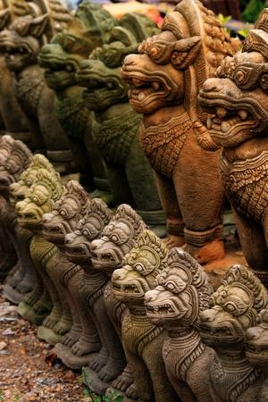 lion figurines: Stone Buddhist statues, Bangkok, Thailand.