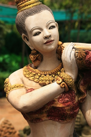 Stone Buddhist statue, Bangkok, Thailand.  photo