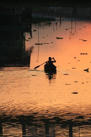 Sunset over a lake, Bangkok, Thailand.  photo