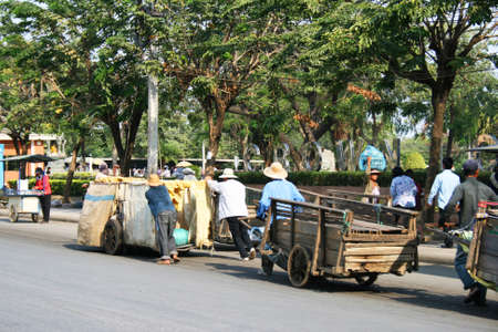 third wheel: POI PET, THAILAND - JANUARY 19: People pull carts on the road on the Thai Cambodian border on January 19, 2011 in Thailand.