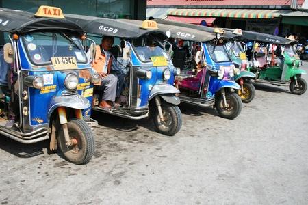 BANGKOK - JANUARY 19: Thai Tuk Tuk taxis on Khaosarn road on January 19, 2011 in Bangkok, Thailand.