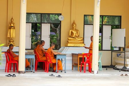 Buddhist monks learning, Bangkok, Thailand. Stock Photo - 10728415