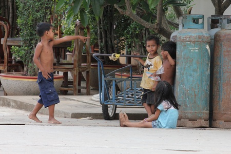 Cambodia -  July, 2011, Cambodian children on the streets of a Thailand border town. Stock Photo - 10580708