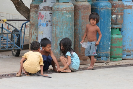 third world economy: Cambodia -  July, 2011, Cambodian children on the streets of a Thailand border town.