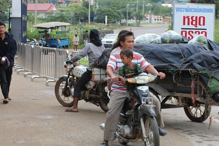 third wheel: Cambodian people transporting food from Thailand to Cambodia.