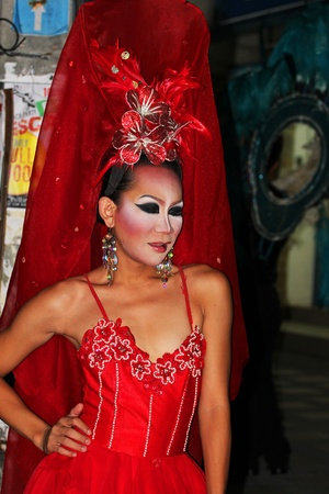 KOH SAMUI, THAILAND - SEPTEMBER 14: Transvestites stand at night in Haad Chewang nightclub area advertising the Miss Tiffany drag queen show in Chewang on September 14, 2011 in Koh Samui.