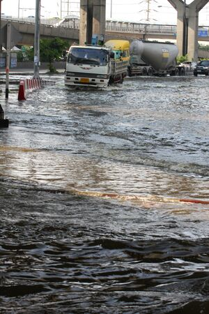 PRATHUMTHANI, THAILAND - OCTOBER 23: Heavy flooding from monsoon rain in Ayutthaya and north Thailand arriving in Bangkok suburbs on October 23, 2011 in Prathumthani, Thailand.  Stock Photo - 11414328