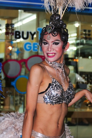 Transvestites stand at night in Haad Chewang nightclub area advertising the Miss Tiffany drag queen show