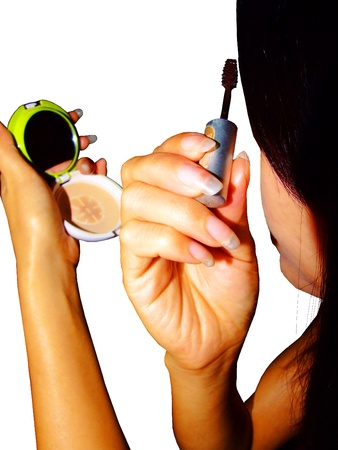 Asian woman applying make up  photo