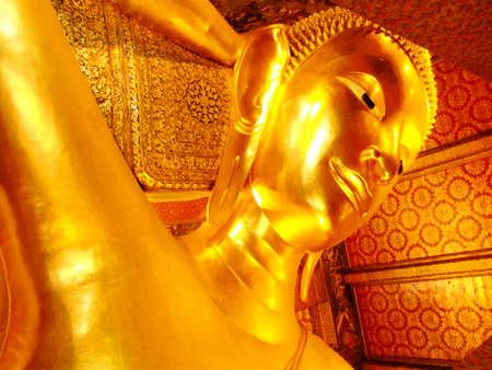 Reclining Buddha in Wat Pho, Bangkok, Thailand   photo