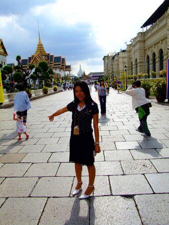 Traveling girl at the Grand Palace in Bangkok, Thailand  photo